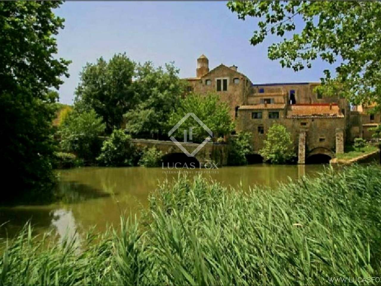 Unique riverside country property for sale comprising various different residences in a superb location close to the beaches of the Costa Brava - ideal potential hotel business