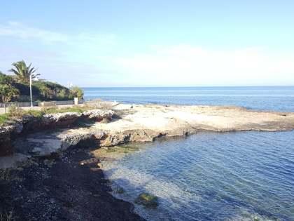 Exclusiva parcela en venta en Las Rotas con vistas al mar