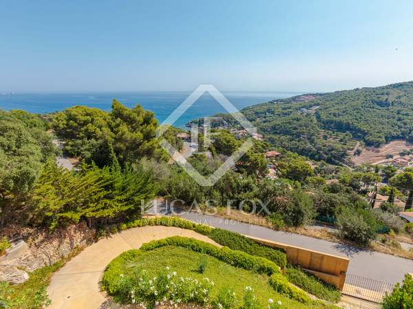 Modern villa for sale with a pool and views of Sa Riera bay